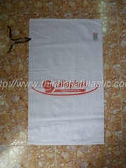 Bag for packaging goods with tie strings