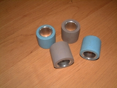 Rubber cot with aluminium bushing