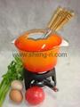 Cast iron fondue pot