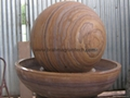 Rainbow sandstone sphere and Granite