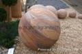 Rainbow sandstone sphere,drilled