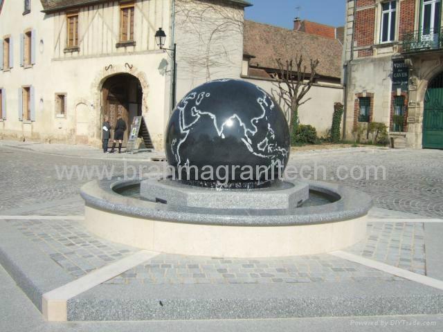 rotating granite sphere