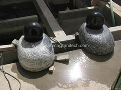 Rolling globe fountains, granite water features