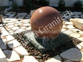 gray stone ball fountain,Spinning sphere