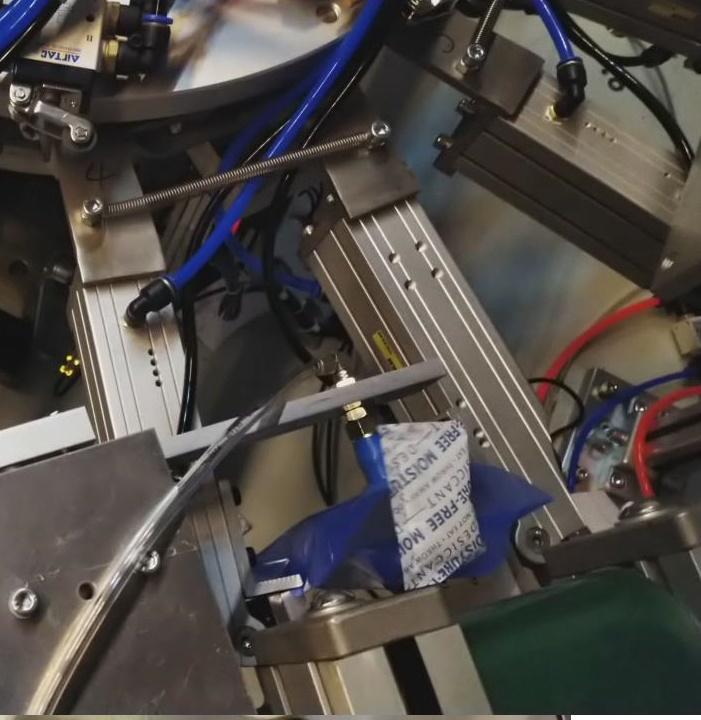 自動迴轉式包裝機&二次上袋裝袋 6