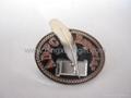 Stamped soft enamel pin