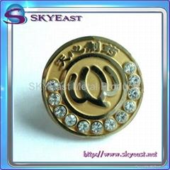Gold metal pin badge with rhinestones