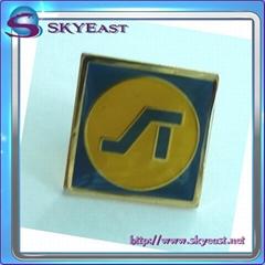 Gold metal pin badge with enamel
