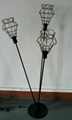 metal floor lamp with black cage shade