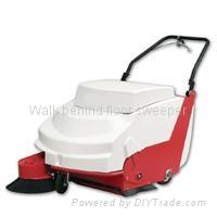 Walk behind floor sweeper sweeping