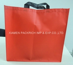 Red non woven shopping bag with black handle