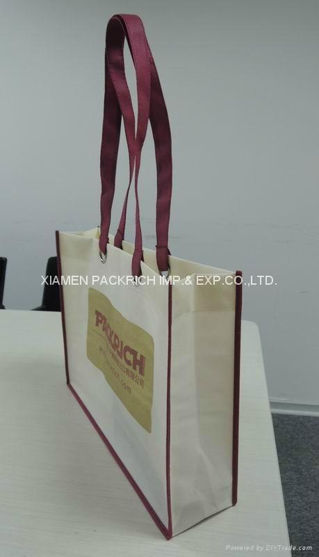 Cheap long handle with big eyelet non woven shopping bag 2
