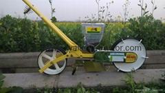 Manual onion seeder