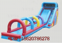 Inflatable pool combination of water slides