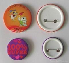 tin badge