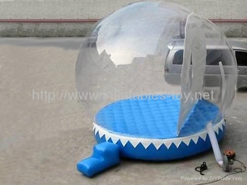 Inflatable snow globe with air matt