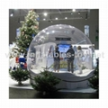 Taking photos inflatable snow globe with Christmas backdrop