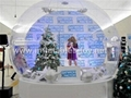 Taking photos inflatable snow globe with Christmas Tree and Backdrop