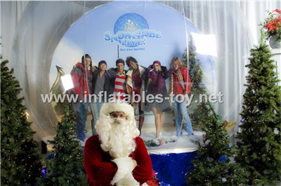 Giant take photos human snow globe
