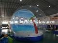 take photos snow globe