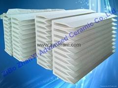 Ceramic fiber side feed nozzle
