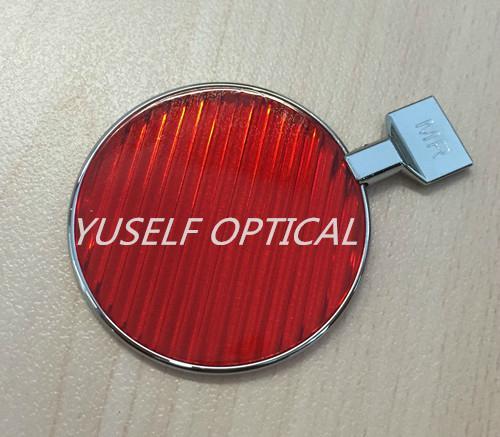 Red maddox lens