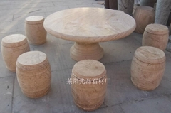 Yellow sandstone tables and chairs with wood grain