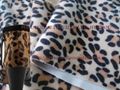 Flocked mink fur with animal print