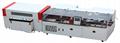 Medium speed sealing and cutting shrink packaging machine