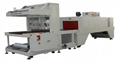 Sleeve type sealing and cutting shrink packaging machine (wire round type)