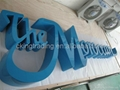 Painting fabricated steel letter sign