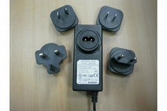 12V2A Power Adapter with interchangeable plugs for UK/EU/AU/US