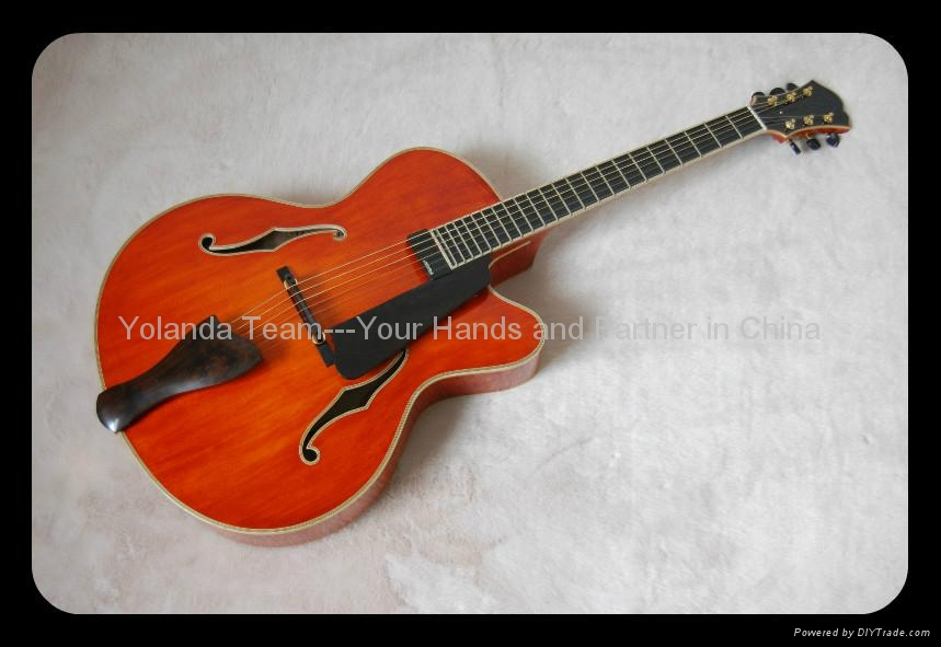 Handmade electric jazz guitar with sideport 1