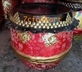 High pitch drum with gold handles and