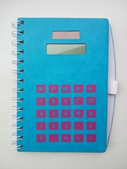 70 pages of notebook with calculator and pen
