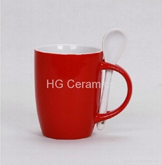 red color mug with spoon