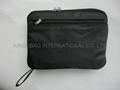 Foldable polyester backpack black color, promotional foldable rucksack