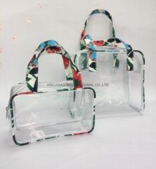 Transparent PVC cosmetic carrying case with carrying handles