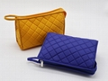 Bright yellow nylon quilted women makeup bag with snap at side for travel