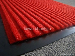 Door mat with PVC backin