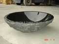 Granite bowl sink with natural cleft finish exterior