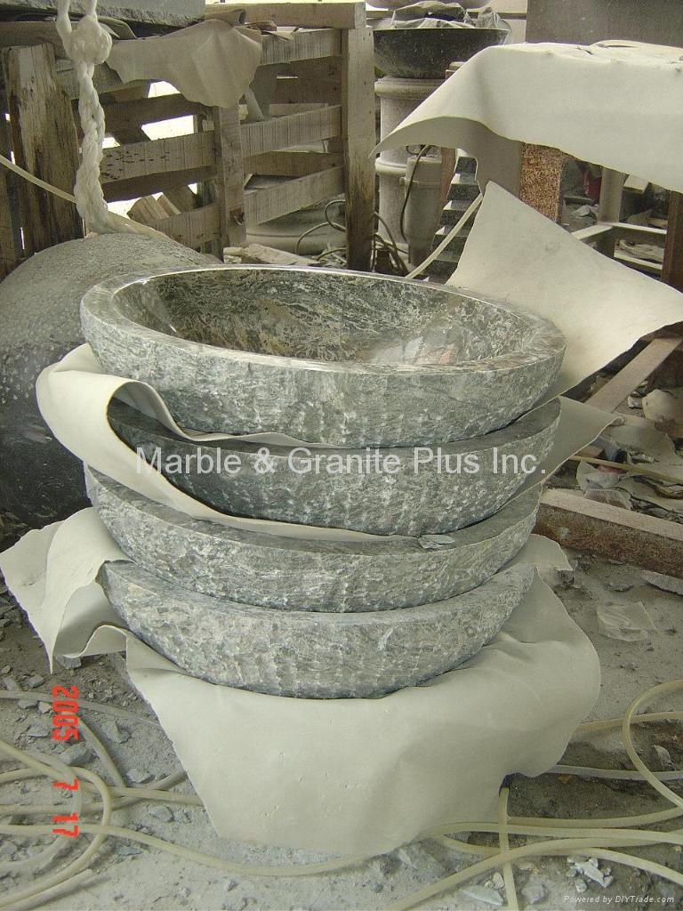 Natural cleft fish bowl sink 1