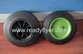 Wheelie bin wheel with colored rim