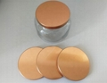 Flat metal lid for candle container