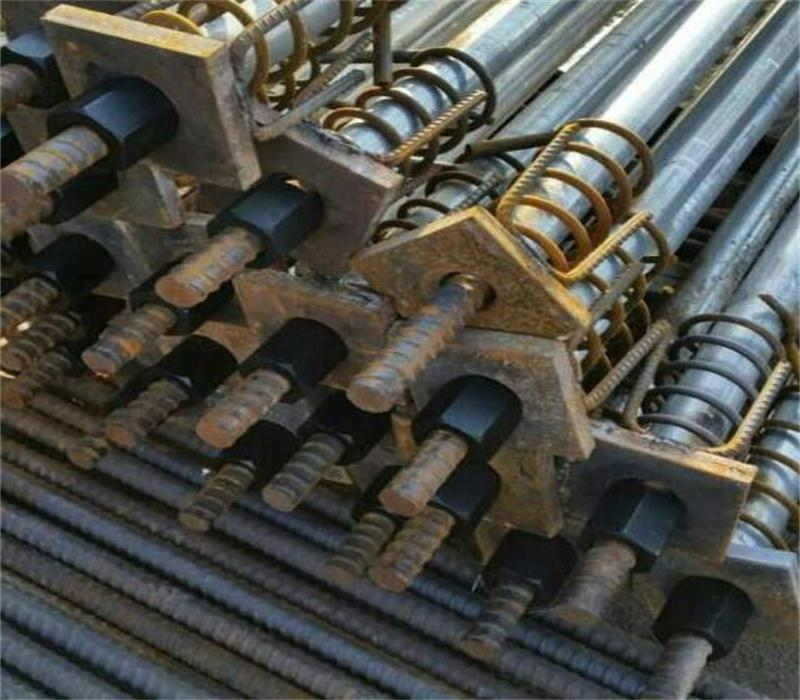 Coupling, nut and plate for post-tensioning bar 9
