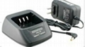 Two way radio battery charger for
