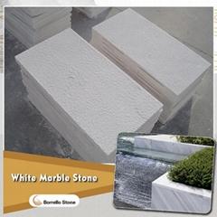 bush hammered white marble stone