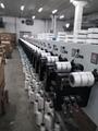 Polyester filament core-spun yarn winder