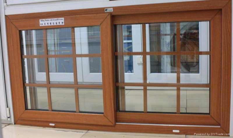 Wooden color laminated pvc sliding window wsw 28 for Sliding wooden window design