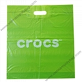 Patch handle plastic bag with virgin material